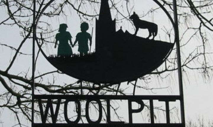 Village sign depicting the two green children, erected in 1977