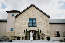 A couple in front of house