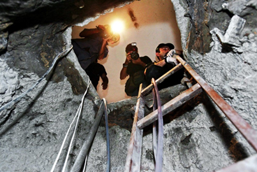 photographers taking picture of tunnel