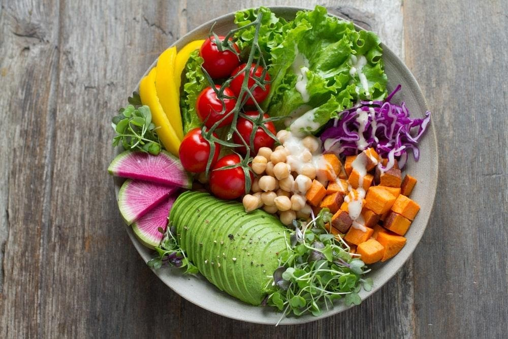 a plate of food with vegetables
