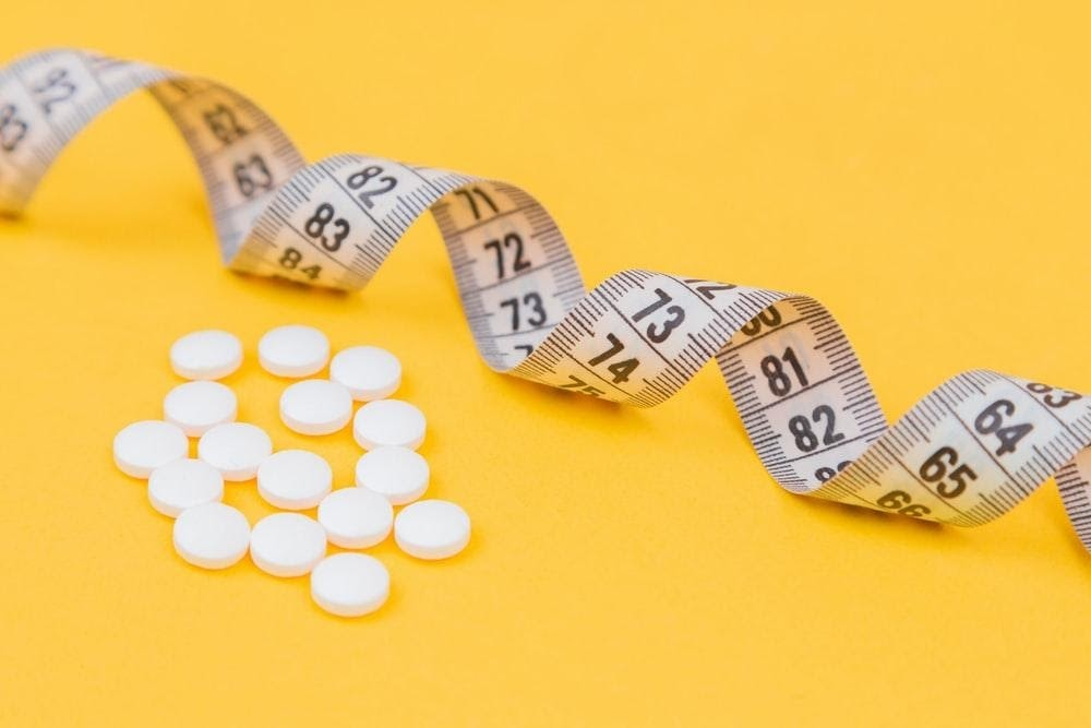 Measuring tape with some pills