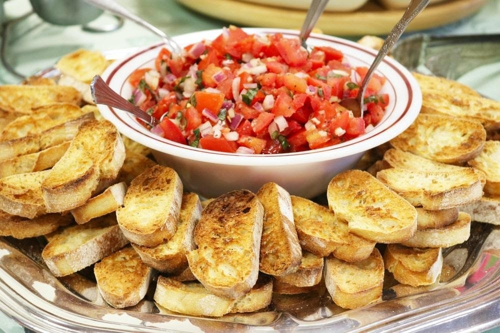 A plate with salad and fried potatoes.