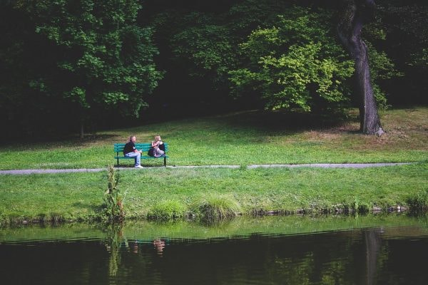 pair sitting on a bench