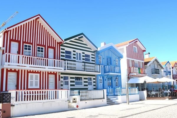 A front view of colorful houses